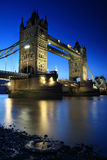 Tower Bridge - reflected over the Thames. Tower Bridge and its reflection in the Thames Stock Photo