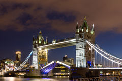 Tower Bridge with reflections at sunset in London, UK. Stock Photos