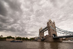 Tower Bridge and the River Thames. Of cloudy sky background stock image