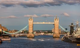 Tower Bridge on River Thames, London, England. Iconic turreted bridge close to H.M.S. Belfast on right and Tower of London at left stock images