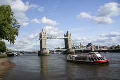 Cruise boat tower bridge river thames london uk Royalty Free Stock Photography