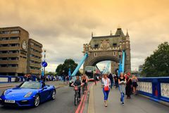 Tower Bridge road Central London United Kingdom. View of A100 looking south to Tower Bridge-the most famous bridge in the world, and the Tower of London walls Stock Photo