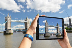 Tower bridge on the screen of  tablet Royalty Free Stock Photography