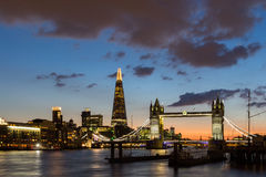Tower Bridge, the Shard, city hall and business district in the. Background at night, London, Uk Royalty Free Stock Image