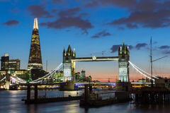 Tower Bridge, the Shard, city hall and business district in the. Background at night, London, Uk Royalty Free Stock Photo