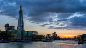 Tower Bridge, the Shard, city hall and business district in the. Background at night, London, Uk Stock Images