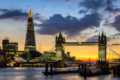 Tower Bridge, the Shard, city hall and business district in the. Background at night, London, Uk Stock Image