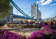 Tower Bridge from the South Bank, London. With tourists enjoying refreshments stock images