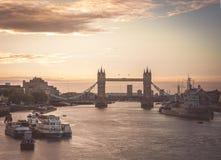 Tower bridge at sunrise. The beautiful sunrise behind the Tower Bridge and the HMS Belfast warship, London, England, UK Stock Images