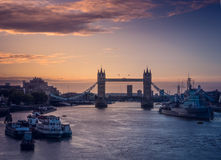 Tower bridge at sunrise. The beautiful sunrise behind the Tower Bridge and the HMS Belfast warship, London, England, UK Stock Photos