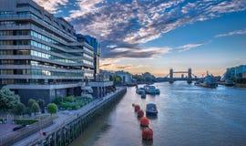Tower bridge at sunrise. The beautiful sunrise behind the Tower Bridge and the HMS Belfast warship, London, England, UK Stock Photo
