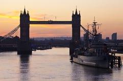 Tower Bridge Sunrise in London. The beautiful sunrise behind Tower Bridge and the HMS Belfast in London Stock Photo