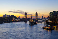 Tower Bridge Sunrise in London. London sunrise with Tower Bridge, HMS Belfast and the River Thames in the foreground Stock Image