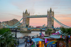 Tower Bridge after sunset with market in foreground Royalty Free Stock Photos