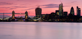 Tower Bridge Sunset Panorama. Panoramic shot of Tower Bridge and the City of London at sunset. A spectacular red sunset Royalty Free Stock Image
