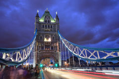 Tower Bridge on dusk, Thames, London, UK, England. Tower Bridge after sunset on a stormy day, crowded with traffic, river Thames royalty free stock photos