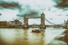 Tower Bridge and Thames River, blurred view with long exposure.  stock photo