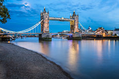 Tower Bridge and Thames River Lit by Moonlight at the Evening Stock Photo