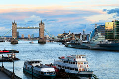 Tower Bridge and Thames. Sunset on the London cityscape, showing Tower Bridge, Thames river end City Hall royalty free stock image
