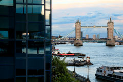 Tower Bridge and Thames. View of Tower Bridge in London through the exterior of Northern and Shell building stock images
