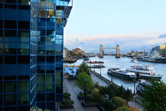Tower Bridge and Thames. View of Tower Bridge in London through the exterior of Northern and Shell building royalty free stock images