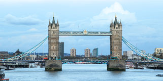 Tower Bridge and Thames. View of Tower Bridge and Thames river in London against cumulus clouds in a blue sky royalty free stock image