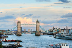 Tower Bridge and Thames. View of Tower Bridge and Thames river in London against cumulus clouds in a blue sky stock photo