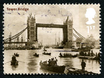Tower Bridge UK Postage Stamp. GREAT BRITAIN - CIRCA 2002: A used postage stamp from the UK, depicting an early image of Tower Bridge in London, circa 2002 royalty free stock photography