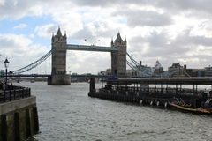 Tower Bridge. Under clouwdy sky with view of ponton in front of Bridge in London Royalty Free Stock Photos