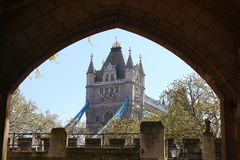 Tower Bridge. Viewed through an archway in the tower of london Stock Photo