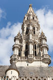 Tower of Brussels City Hall in telephoto shot. Ornate Brussels Town Hall in Grand Place with detail of tower stock images