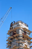 Tower building under construction with crane Royalty Free Stock Images