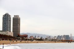 The skyline of Barcelona with the sea, the beach and modern buildings. Tower buildings soar along the sea of Barcelona royalty free stock photos