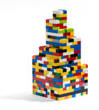 Tower built of colorful plastic building blocks Royalty Free Stock Photos