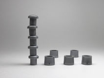 Tower, built of legs and caps of stands for discs. The tower, built of legs and caps of stands for discs Royalty Free Stock Photo