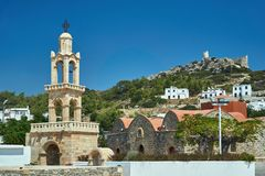 Tower of the Byzantine church and the ruins of the medieval castle. In Asklipio on the island of Rhodes royalty free stock images