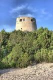 Tower of Cala Pira in Sardinia. Italy, mediterranean, bay, beach, blue, sky, sea, coast, water, europe, villasimius, ocean, road, coastline, seascape stock photos