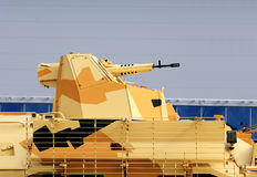 Tower of the camouflaged armored personnel carrier Royalty Free Stock Photos