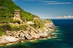 Corsica old tower. Tower on Cap Corse peninsula and rocky cliffs, Corsica, France Stock Image