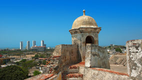 Tower of the Castillo San Felipe de Barajas with modern buildings in the background. Stock Photography
