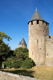 Tower of the castle. Towers and pit of the Castle of the Cite of Carcassonne during a sunny morning royalty free stock image
