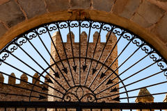 Tower of a castle behind a elegant iron gate Stock Image