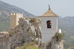 Tower of the castle and bell tower on el castell de guadalest Royalty Free Stock Image