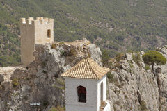 Tower of the castle and bell tower on el castell de guadalest Stock Photography