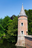 Tower in the castle moat Stock Images