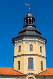 Tower of the castle in Nesvizh on a background of blue sky Royalty Free Stock Images
