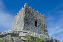 Tower of the castle of Sortelha. Portugal. Romanesque style medieval castle in the Sabugal municipality. Distrito de Guarda, As Beiras Region. Portugal royalty free stock photo