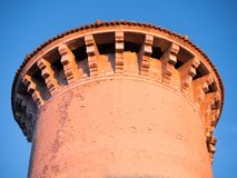 Tower castle sunset against clear blue sky stock image