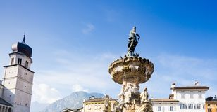 Tower of cathedral Trento and fountain with Neptune, Italy royalty free stock photos