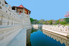 Tower and channel of famous Buddhist Temple of the Tooth Relic in Kandy, Sri Lanka. Stock Image